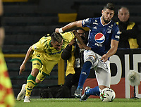 BOGOTA - COLOMBIA, 03-02-2019: Matias De Los Santos de Millonarios disputa el balón con John Fredy Perez de Bucaramanga durante partido por la fecha 3 de la Liga Águila I 2019 entre Millonarios y Atlético Bucaramanga jugado en el estadio Nemesio Camacho El Campin de la ciudad de Bogotá. / Matias De Los Santos of Millonarios fights for the ball with John Fredy Perez of Bucaramanga during match for the date 3 of the Liga Aguila I 2019 between Millonarios and Atletico Bucaramanga played at the Nemesio Camacho El Campin Stadium in Bogota city. Photo: VizzorImage / Gabriel Aponte / Staff.