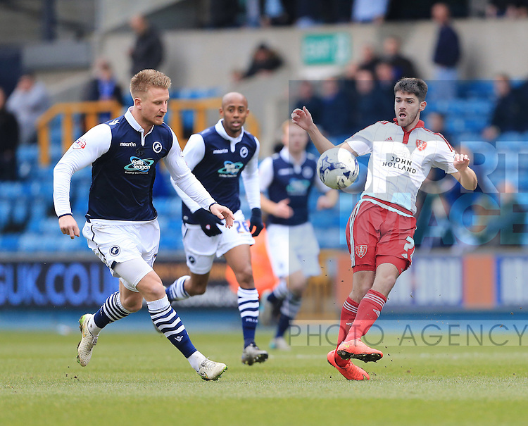 Millwall's Byron Webster tusles with Sheffield United's Ryan Flynn during the League One match at The Den.  Photo credit should read: David Klein/Sportimage