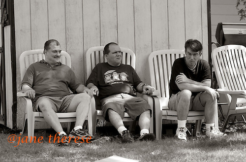 Larry, Michael and David all autistic men on Monday May 29, 2006 at The Sobolevitch House during a Memorial Day picnic in Robbinsville, NJ. photo by jane therese