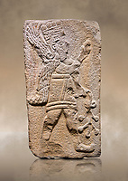 Aslantepe Hittite relief sculpted orthostat stone panel. Limestone, Aslantepe Malatya, 1200-700 B.C. Anatolian Civilisations Museum, Ankara, Turkey.<br /> <br /> Winged protective god holds a branch with fruits. in his left hand, and a fruit in his right hand.<br /> <br /> Against a brown art background.