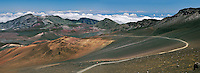 Hikers along the panoramic sliding sands trail in the crater of HALEAKALA NATIONAL PARK on Maui in Hawaii