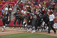NWA Democrat-Gazette/J.T. WAMPLER The Arkansas squad meets Hannah McEwen at home plate after her homer in the fourth inning against Wichita State Sunday May 20, 2018 during the NCAA Regional Softball Tournament at Bogle Park in Fayetteville. Arkansas won 6-4.