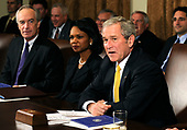 United States President George W. Bush (R), seated next to US Secretary of State Condoleezza Rice (C) and US Secretary of Interior Dirk Kempthorne, delivers remarks to the media following a meeting with his Cabinet, in the Cabinet Room at the White House in Washington on January 13, 2009.<br /> Credit: Kevin Dietsch / Pool via CNP