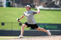Chicago White Sox minor league pitcher John Parke delivers a pitch during live batting practice on Tuesday, June 2, 2020, at Fluor Field at the West End in Greenville, South Carolina. Team workouts have been shut down during the coronavirus pandemic, so this group began working out in what they call game situation simulations a couple of days a week. Parke was drafted out of South Carolina. (Tom Priddy/Four Seam Images)