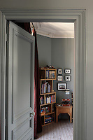 The two boys' bedrooms are interconnected and painted the same flat elephant grey