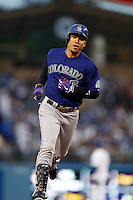 Carlos Gonzalez #5 of the Colorado Rockies runs the bases during a game against the Los Angeles Dodgers at Dodger Stadium on April 30, 2013 in Los Angeles, California. (Larry Goren/Four Seam Images)