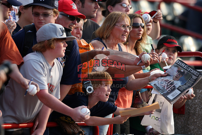 Fans looking for an autograph from Harrisburg Senators outfielder Bryce Harper before a game against the Erie SeaWolves at Jerry Uht Park on August 6, 2011 in Erie, Pennsylvania.  Harrisburg defeated Erie 10-6.  (Mike Janes/Four Seam Images)