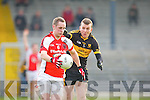 Conor O'Sullivan Rathmore goes past  Luke Quinn Crokes during the O'Donoghue Cup final in Fitzgerald Stadium on Sunday