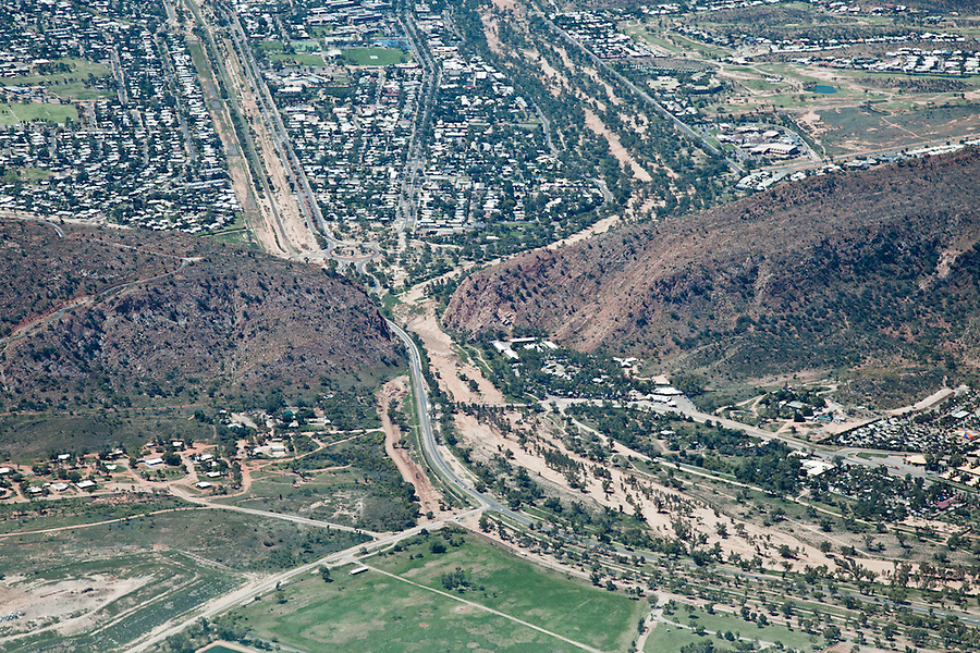 Aerial view of Alice Springs, showing The Todd River,Stuart Highway and Ghan Railway passing through a break in the MacDonnell Ranges called Heavitree Gap