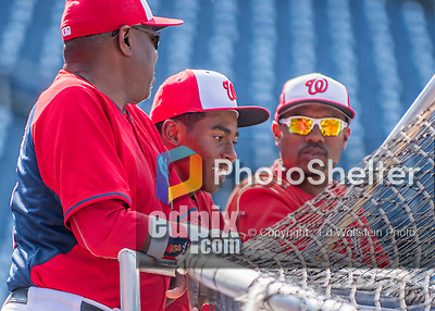 22 July 2016: Son of Washington Nationals Manager Dusty Baker, Darren Baker watches batting practice with his dad and assistant hitting coach Jacque Jones prior to a game against the San Diego Padres at Nationals Park in Washington, DC. The Padres defeated the Nationals 5-3 to take the first game of their 3-game, weekend series. Mandatory Credit: Ed Wolfstein Photo *** RAW (NEF) Image File Available ***