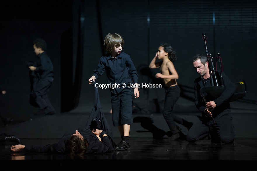 London, UK. 28.01.2014. Boris Charmatz/ Musee de la Danse presents ENFANT, in its UK premiere at Sadler's Wells. Photograph shows: Erwan Keravec (Bagpipes) and the ensemble. Photograph © Jane Hobson.