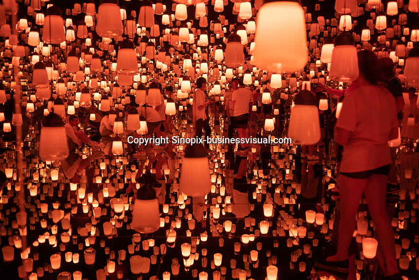 "The ""Forest of Lamps"" room in Team Lab's Borderless digital museum in Tokyo, Japan, July, 2019. The digital museum is one of Tokyo's most popular attractions and uses innovative digital audio-visual displays."