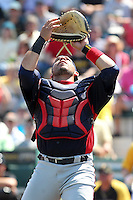 Minnesota Twins catcher Rene Rivera #32 catches a pop up during a spring training game against the Pittsburgh Pirates at McKechnie Field on March 10, 2012 in Bradenton, Florida.  Minnesota defeated Pittsburgh 4-2.  (Mike Janes/Four Seam Images)