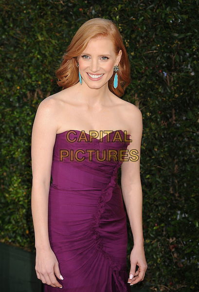 "Jessica Chastain.arriving at the Los Angeles Premiere of ""The Help"" at the Samuel Goldwyn Theater inside the Academy of Motion Picture Arts and Sciences in Beverly Hills, California, USA, August 9th 2011..half length purple long maxi strapless dress  ruffle .CAP/ROT/TM.©TM/Roth Stock/Capital Pictures"