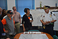 April 26, 2013  (Baltimore, Maryland) Major Robert Smith briefs Baltimore Mayor Stephanie Rawlings-Blake (c) and San Francisco Mayor Edwin M. Lee (l) on crime data mapping at a Baltimore police station. Mayor Lee visited Baltimore for a day of community service and toured the station. (Photo by Don Baxter/Media Images International)