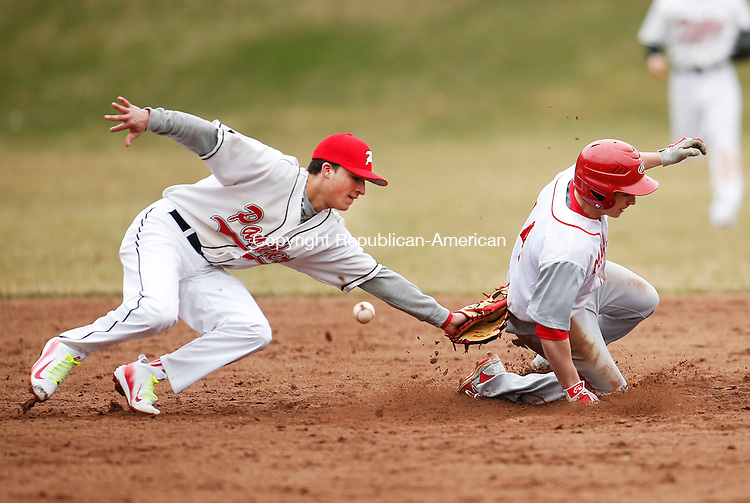 Southbury, CT- 09 April 2015-040915CM06-  Pomperaug's Nate Zappone (left) attempts to tag out  Masuk's Anthony Amoroso in Southbury on Thursday.  Although Amoroso was called safe on the steal, Pomperaug would go on to win, 5-4 in 9 innings.  Christopher Massa Republican-American