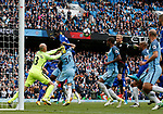 Wilfredo Caballero of Manchester City punches the ball clear as Kasper Schmeichel of Leicester City comes up for a last minute attack during the English Premier League match at the Etihad Stadium, Manchester. Picture date: May 13th 2017. Pic credit should read: Simon Bellis/Sportimage