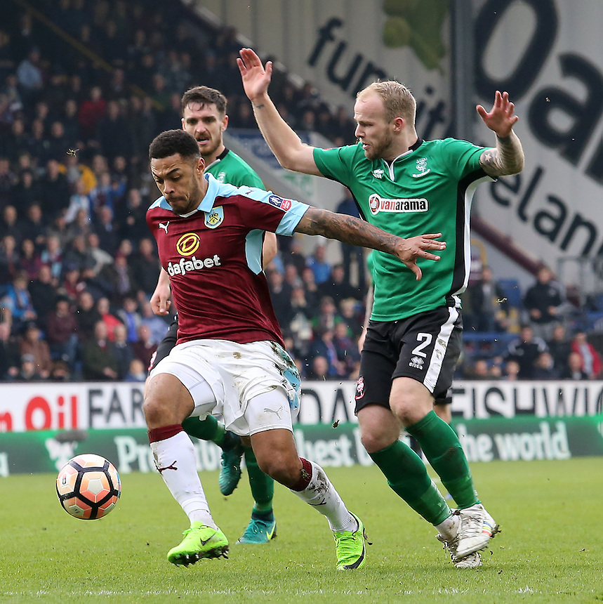 Burnley's Andre Gray battles past Lincoln City's Bradley Wood<br /> <br /> Photographer David Shipman/CameraSport<br /> <br /> Emirates FA Cup Fifth Round - Burnley v Lincoln City - Saturday 18th February 2017 - Turf Moor - Burnley <br />  <br /> World Copyright &copy; 2017 CameraSport. All rights reserved. 43 Linden Ave. Countesthorpe. Leicester. England. LE8 5PG - Tel: +44 (0) 116 277 4147 - admin@camerasport.com - www.camerasport.com