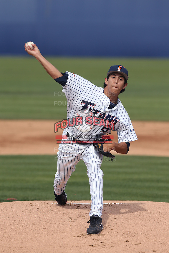 Justin Garza #8 of the Cal State Fullerton Titans pitches against the Washington State Cougars at Goodwin Field on  February 15, 2014 in Fullerton, California. Washington State defeated Fullerton, 9-7. (Larry Goren/Four Seam Images)