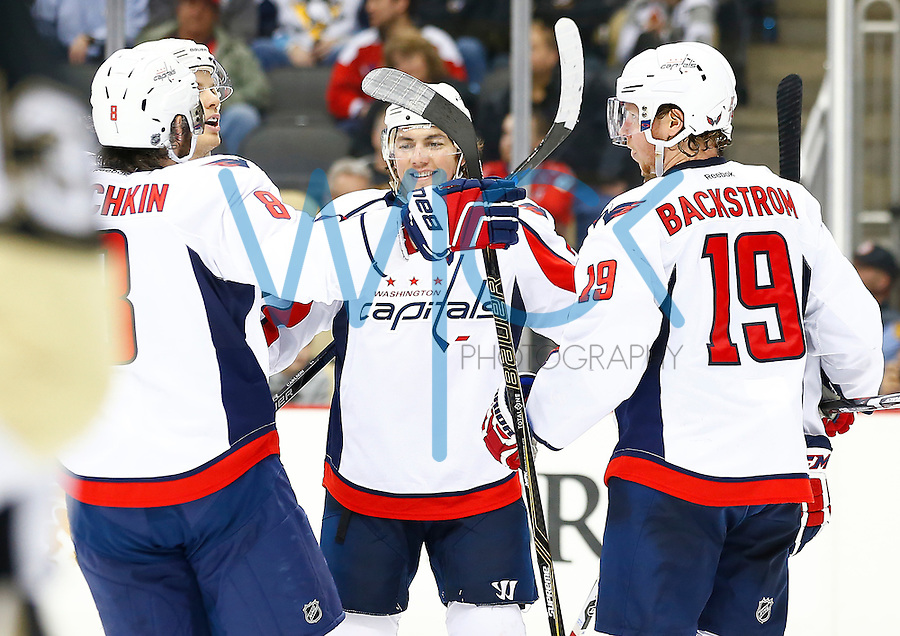T.J. Oshie #77 of the Washington Capitals celebrates his goal in the third period against the Pittsburgh Penguins during the game at Consol Energy Center in Pittsburgh, Pennsylvania on December 14, 2015. (Photo by Jared Wickerham / DKPS)