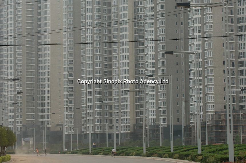 Empty flats in Zhengdong New City in Henan Province, China. The new city adjacent to Zhengzhou will be built from scratch and house over 1.5 million people when it is complete in 2015. It is the first time that the Chinese are attempting to build a whole city from nothing. .03 Aug 2005.....