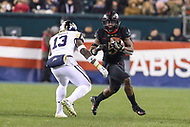 Philadelphia, PA - December 8, 2018:  Army Black Knights running back Kell Walker (5) tries to avoid Navy Midshipmen safety Juan Hailey (13) during the 119th game between Army vs Navy at Lincoln Financial Field in Philadelphia, PA. (Photo by Elliott Brown/Media Images International)