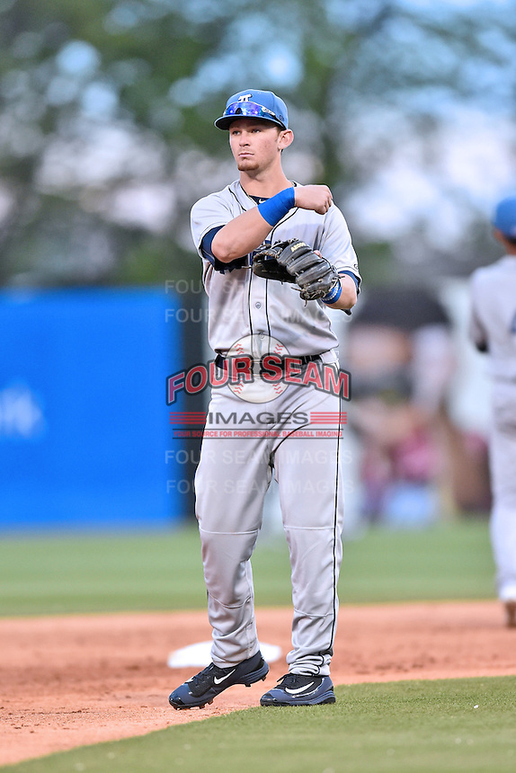 Asheville Tourists shortstop Brendan Rodgers (1) warms up between innings during a game against the Greenville Drive at Fluor Field on April 7, 2016 in Greenville South Carolina. The Drive defeated the Tourists 4-3. (Tony Farlow/Four Seam Images)