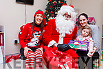 Children from the Cashel Ward in University Hospital Kerry were delighted to Santa stop by on Friday afternoon. Pictured with Anne the elf and Santa were: Susan Cotter with her seventeen month old daughter Ava.