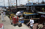 Halong-Vietnam, Ha Long - Viet Nam - 22 July 2005---Crew of a typical passenger boat load catering goods before cruising with tourists through Halong Bay, a UNESCO World Natural Heritage Site---tourism, traffic, transport---Photo: Horst Wagner/eup-images