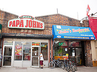 A Papa John's Pizza franchise on Lenox Avenue in Harlem in New York on Saturday, July 28, 2012. (© Richard B. Levine)
