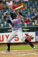 Omaha Storm Chasers third baseman Irving Falu #12 at bat during the Pacific Coast League baseball game against the Round Rock Express on July 20, 2012 at the Dell Diamond in Round Rock, Texas. The Chasers defeated the Express 10-4. (Andrew Woolley/Four Seam Images).