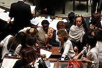 Deputate vestite di bianco per sottolineare il sostegno all'emendamento che prevede le quote rosa nel disegno di legge della riforma del sistema elettorale, durante la discussione alla Camera dei Deputati, Roma, 10 marzo 2014. Al centro, l'ex ministro per l'integrazione Cecile Kyenge.<br /> Lawmakers wearing in white to mark their support to the amendment on gender parity in the new electoral law, during the discussion at the Lower Chamber in Rome, 10 March 2014. At center, former integration minister Cecile Kyenge.<br /> UPDATE IMAGES PRESS/Riccardo De Luca