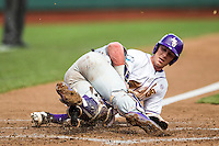 LSU Tigers second baseman Jared Foster (17) is blocked from the plate by TCU Horned Frogs catcher Evan Skoug (9) blocks the plate during the NCAA College World Series on June 14, 2015 at TD Ameritrade Park in Omaha, Nebraska. TCU defeated LSU 10-3. (Andrew Woolley/Four Seam Images)