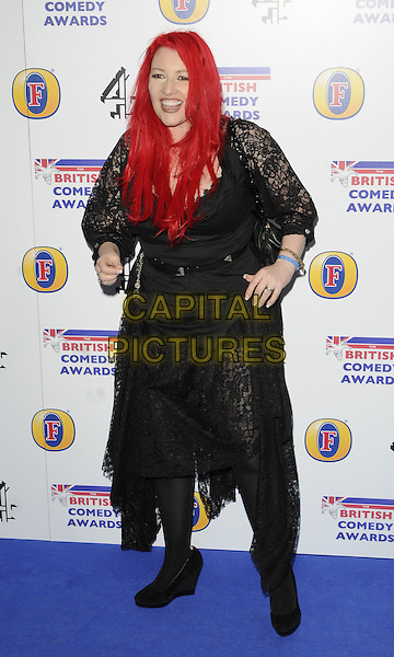 JANE GOLDMAN .Attending the British Comedy Awards 2011at Indigo, The O2 Arena, London.England, UK, January 22nd, 2011..arrivals full length black dress lace hands on hips tights belt .CAP/CAN.©Can Nguyen/Capital Pictures.