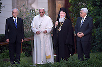 Pope Francis arrives with Palestinian leader Mahmud Abbas  and Israeli President Shimon Peres and Orthodox Patriarch Bartholomew,for a joint peace prayer in the gardens of the Vatican.June 8, 2014