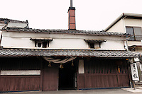 "Exterior of the Tsukinokatsura sake brewery, Fushimi, Kyoto, Japan, October 10, 2015. Tsukinokatsura Sake Brewery was founded in 1675 and has been run by 14 generations of the Masuda family. Based in the famous sake brewing region of Fushimi, Kyoto, it has a claim to be the first sake brewery ever to produce ""nigori"" cloudy sake. It also brews and sells the oldest ""koshu"" matured sake in Japan."