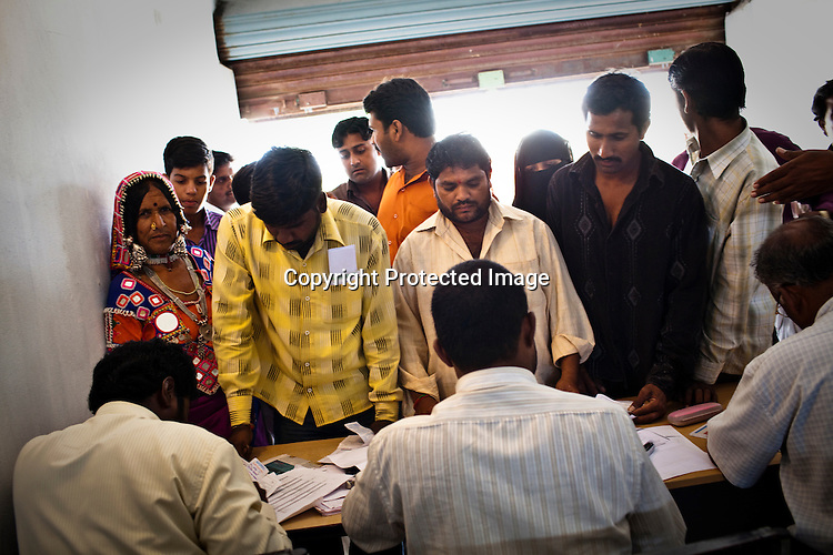 Enrollment is on its way in Naagaaram village, outskirts of Hyderabad in Andhra Pradesh, India. India is assigning each one of its 1.2 billion people a unique ID number based on digital finger prints and iris scan. Photograph: Sanjit Das/Panos