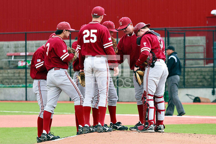 PULLMAN, WA-April 3, 2011:  Stanford infielders and coach Rusty Filter in a game against Washington State University in Pullman, Washington.  Stanford won the game 4-3.