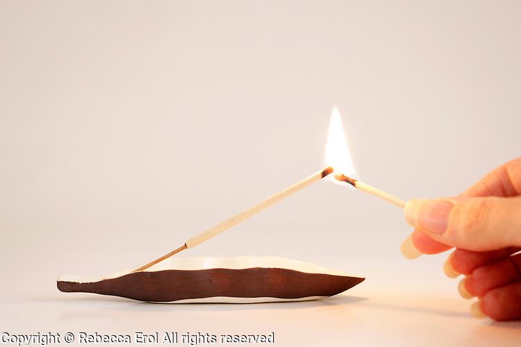 Lighting an incense stick