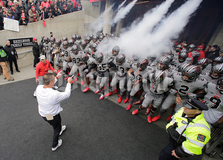 Ohio State Buckeyes head coach Urban Meyer leads his team onto the field prior to the NCAA football game against the Penn State Nittany Lions at Ohio Stadium in Columbus on Oct. 28, 2017. Ohio State is wearing special gray and black uniforms for the matchup of top-10 teams. [Adam Cairns/Dispatch]