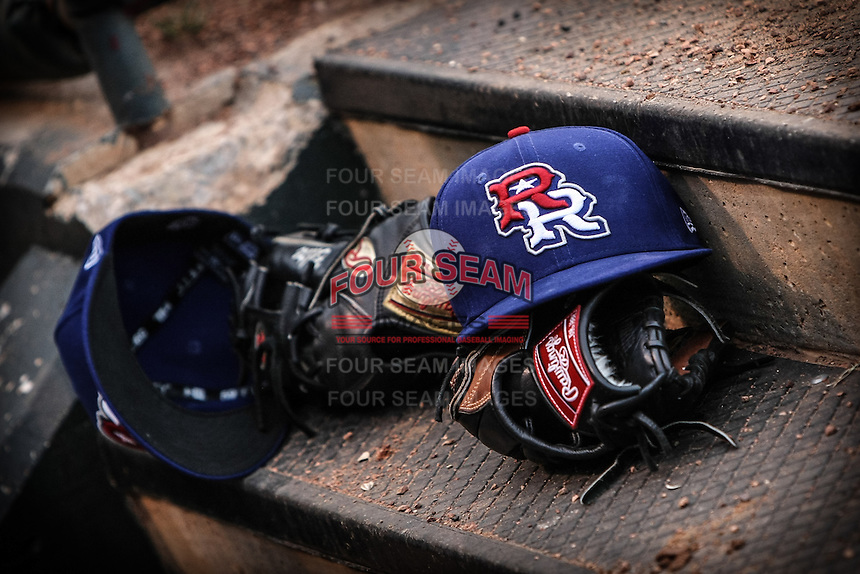 Round Rock Express hats and gloves in the dubout during the Pacific Coast League game against the Oklahoma City RedHawks at Chickashaw Bricktown Ballpark on June 14, 2013 in Oklahoma City ,Oklahoma.  (William Purnell/Four Seam Images)