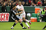 1 November 2007: Chicago's Cuauhtemoc Blanco (10) is challenged by DC United's Greg Vanney (left) after making a pass. The Chicago Fire tied DC United 2-2 at RFK Stadium in Washington, DC in the second leg of a first round Major League Soccer playoff match. Chicago advanced on aggregate goals, 3-2.