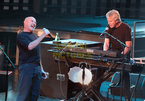 """PHIL COLLINS & TONY BANKS - GENESIS.performs as a part of the re-united Genesis - """"Turn It On Again Tour 2007""""  held at the Mellon Arena, Pittsburgh, Pennsylvania, USA, 09 September 2007. .half length music concert group band gig on stage playing keyboard.CAP/ADM/DS.©Devin Simmons/AdMedia/Capital Pictures."""