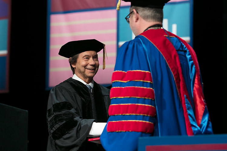 Stuart Dybek, poet and fiction writer, receives an honorary degree Saturday, June 10, 2017, during the DePaul University School for New Learning commencement ceremony at the Rosemont Theatre in Rosemont, IL. (DePaul University/Jeff Carrion)