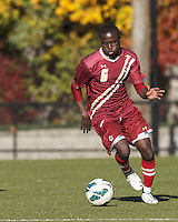 Boston College midfielder/defender Atobra Ampadu (6) brings the ball forward. Boston College (maroon) defeated Virginia Tech (Virginia Polytechnic Institute and State University) (white), 3-1, at Newton Campus Field, on November 3, 2013.