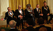 Washington, DC - December 6, 2009 -- Fellow recipients of the 2009 Kennedy Center Honors react to Mel Brooks (left) during an East Room reception in the White House in Washington, D.C., Sunday, December 6, 2009. Shown (l-r) are Mel Brooks, Dave Brubeck, Grace Bumbry, Robert DeNiro, and Bruce Springsteen. .Credit: Martin H. Simon / Pool via CNP