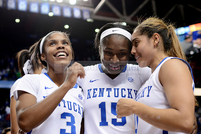 Kentucky Wildcat players Janee Thompson, Linnae Harper and Jennifer O'Neill celebrate their win during the second half against the Baylor Bears at Rupp Arena in Lexington, Ky., on Monday, November 17, 2014.  Kentucky wins 74-64. Photo by Caleb Gregg | Staff.