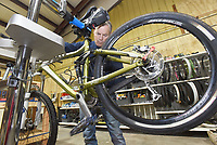 NWA Democrat-Gazette/FLIP PUTTHOFF <br /> PEDAL IT FORWARD<br /> Donn (cq) Schmidt, a volunteer with Pedal It Forward, a nonprofit bicycle repair and distribution group, works on a bike Saturday Jan. 12 2019 at their shop in Rogers. The group repairs and distributes donated bicycles to anyone who needs a bike. Bikes are provided through organizations such as veterans groups and area schools. Bikes are free, but recipients are encouraged to pay what they can. About 20 volunteers repair bikes at the Pedal It Forward locations in Rogers and Bentonville. The group seeks more volunteers and more gently used bicycles, said David Tovey, president. Contact Pedal It Forward at bikes.pedal4ward@gmail.com, 616-915-5784 or see the group's Facebook page.
