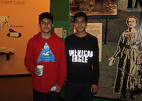 NWA Democrat-Gazette/CARIN SCHOPPMEYER Carlos Gallegos (left) and Danny Maldonado explore Shiloh Museum of the Ozarks during the Cabin Fever Reliever on Jan. 14.