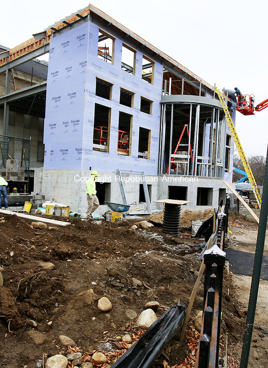 TORRINGTON CT. 01 DECEMBER 2015-120115SV02-Construction continues at the Library in Torrington Tuesday. Workers begun construction in July and is the library's first addition to the Daycoeton Place building since 1926. The addition will add 13,377-square-feet to the facility and, once finished, will be more than 30,000 square feet. Burlington Construction is the general contractor in the $5.7 million project. The addition will add space for more public computer terminals and expand the children's room.<br /> Steven Valenti Republican-American